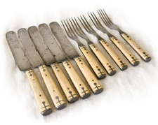 Ivory sets of Forks and Knives